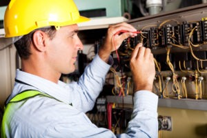 electrician working on a board