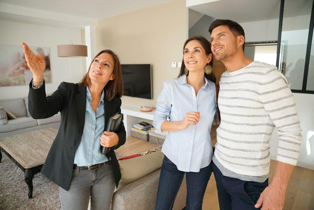 Realtor showing a house to a couple