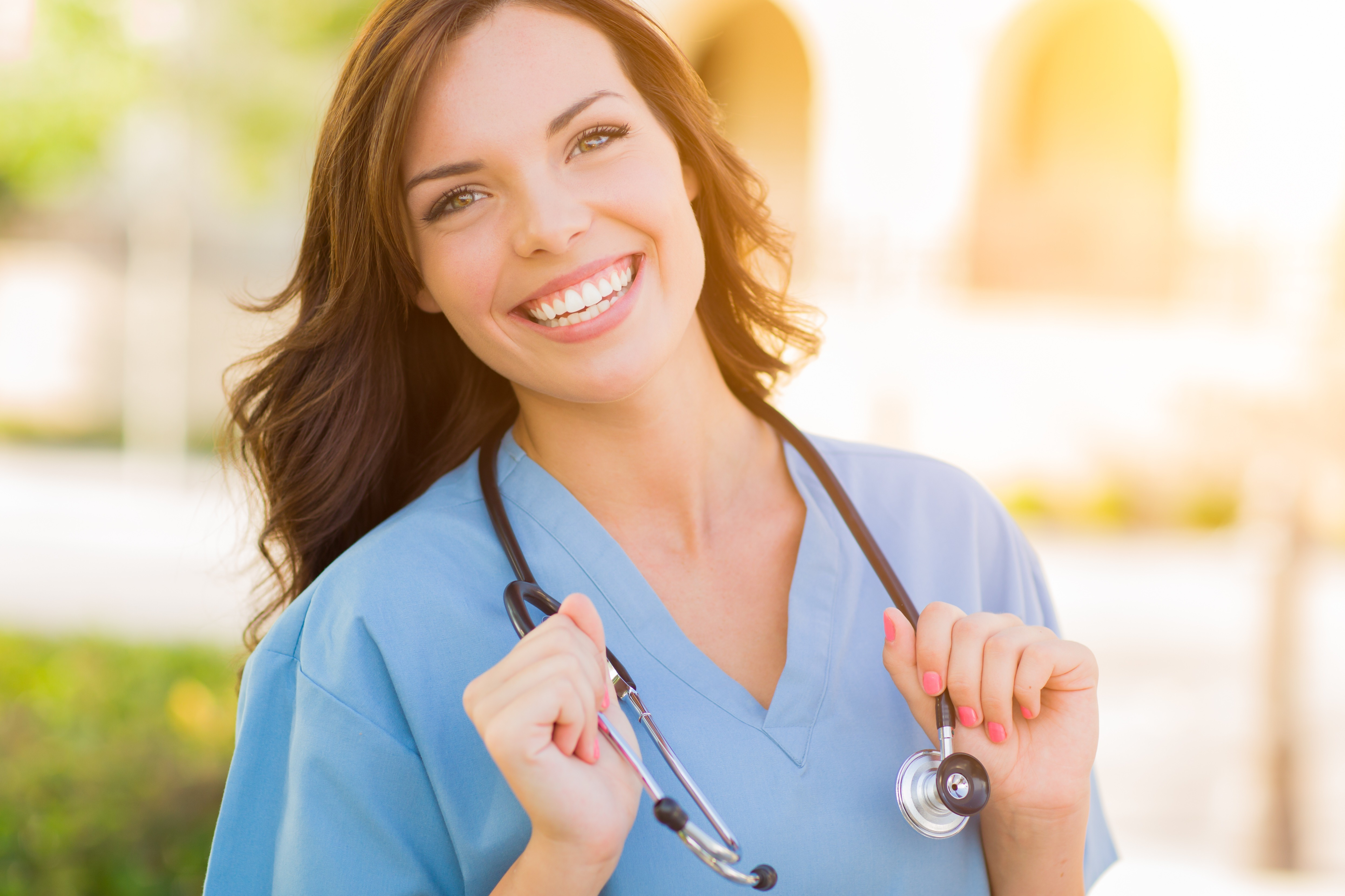 Female Nurse outdoors with stethoscope around her neck